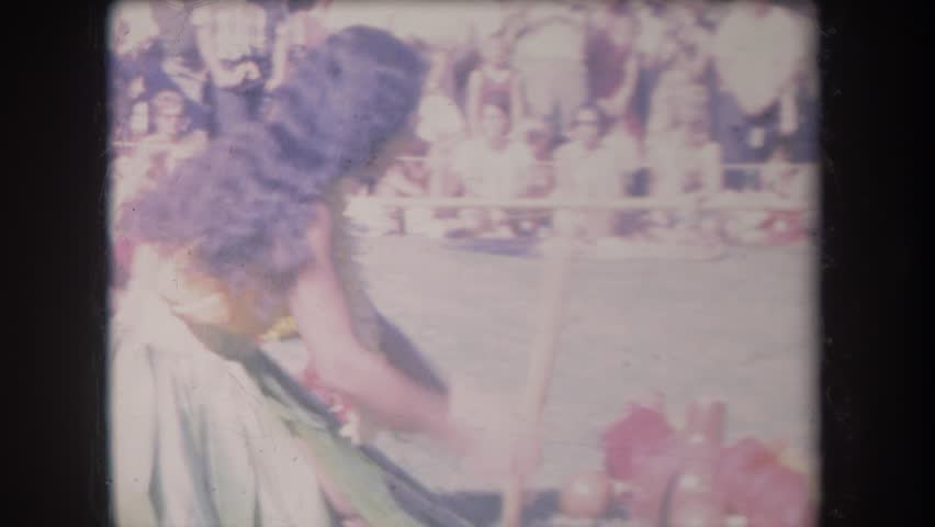 HAWAII 1969: a hawaiian luau with girl playing drums while people are watching | Shutterstock HD Video #22324213
