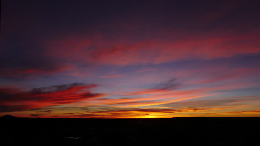 Colorful Sunrise Timelapse over small town. 4K UHD.