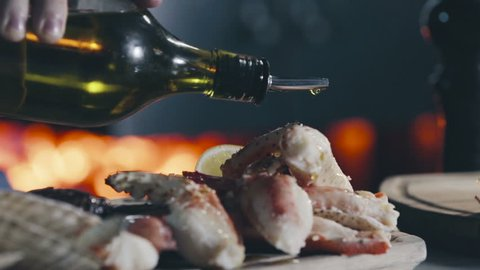 Running olive oil on the Grilled Seafood