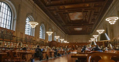 NEW YORK - Circa December, 2016 - An interior low angle establishing shot of the New York Public Library.
