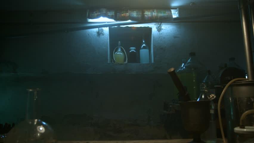 Strange scientist opens a steel box with ingredients