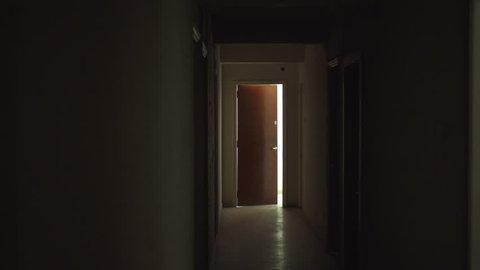 Old dark creepy apartment building,long hallway, gimbal tracking shot