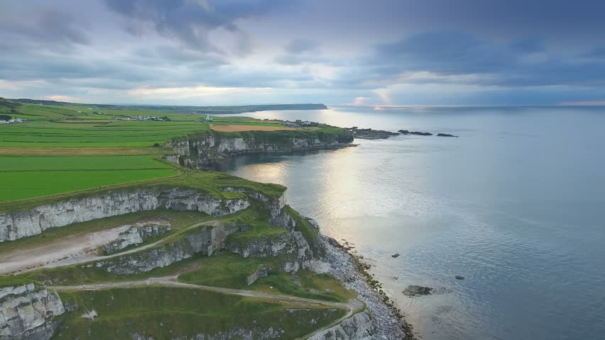 Aerial landscape view of the sea and the cliff in Carrick-a-Rede Rope Bridge tourist destination in North Ireland in Ireland