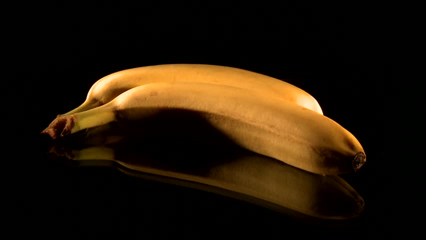 Putting two bananas on a table