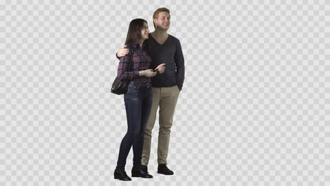 Handsome blonde male and beautiful girl in plaid shirt are standing together and looking at something. Clip with alpha channel