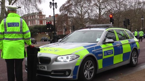 December, 21, 2016, London, UK. Armed police are patrolling Buckingham Palace. Police vehicles were parked and armed police officers.Roads are closed around Buckingham Palace.