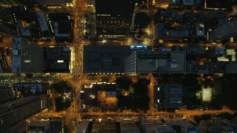 Aerial vertical overhead rooftop illuminated view of Hancock Center Chicago city streets road traffic and Downtown Skyscraper buildings Financial District USA Illinois RED DRAGON