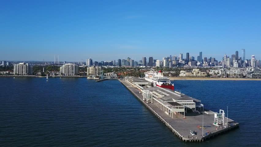 Orbit shot of pier in Port Melbourne and view of skyline in CBD #22509013