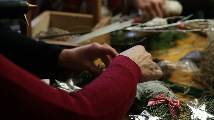 Florist making christmas door wreath. #22518613