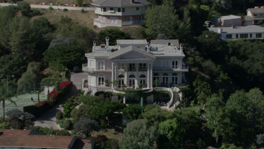 aerial view of a gorgeous white colonial-style mansion circa 2009