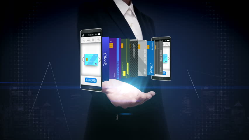 Businesswoman open palm,  Select credit card in smartphone, mobile, concept of mobile payment, select main mobile credit card. | Shutterstock HD Video #22579561