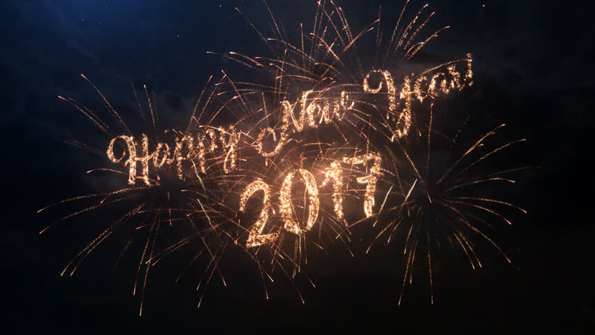 Happy New Year 2017 greeting text with particles and sparks on black night sky with colored slow motion fireworks on background, beautiful typography magic design. | Shutterstock HD Video #22606363