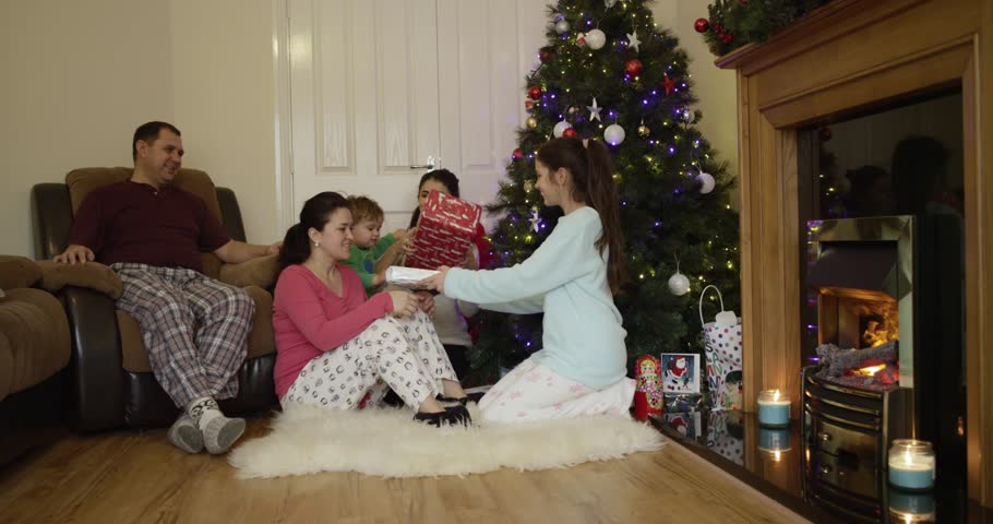At Home Christmas Trees.Happy Family Opening Christmas Presents Stock Footage Video 100 Royalty Free 22615813 Shutterstock