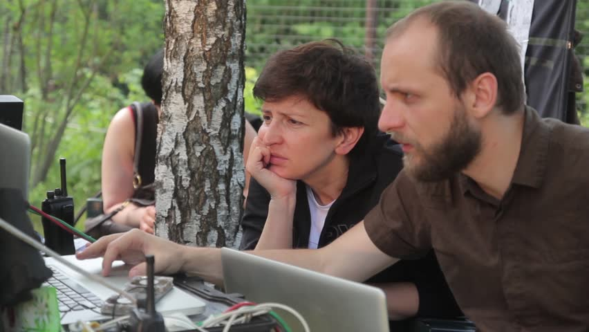 KYIV, UKRAINE  –  JUNE 19, 2015. The Director and assistant Director are looking at the monitor backstag