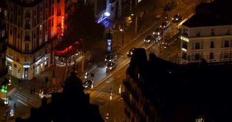 PARIS, FRANCE - CIRCA 2016: Aerial vintage effect look of a busy intersection -aerial of Paris intersection street at night with pedestrians, cars - 8mm