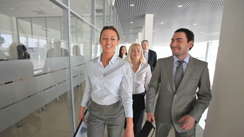 Business people having a small talk on their way to the meeting