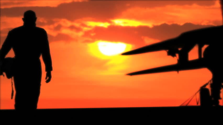 Silhouette of pilot and fighter at sunset | Shutterstock HD Video #2268623