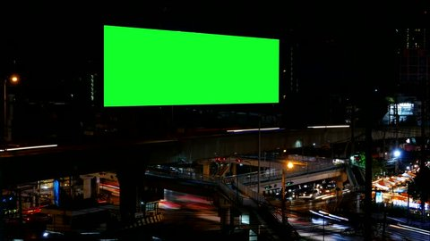Advertising Billboard with green screen and traffic at night, for advertisement, time lapse.