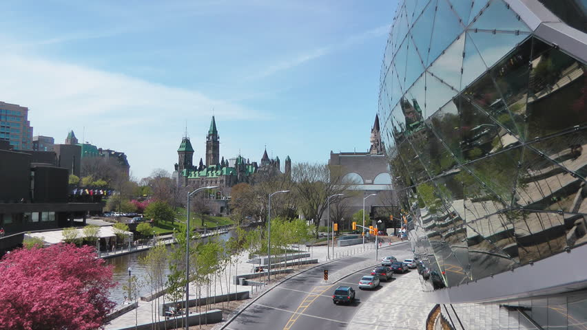 OTTAWA - CIRCA MAY 2012: The new Ottawa Convention Centre, Rideau canal, and the Canadian Parliament Buildings circa May 2012 in downtown Ottawa, Canada.