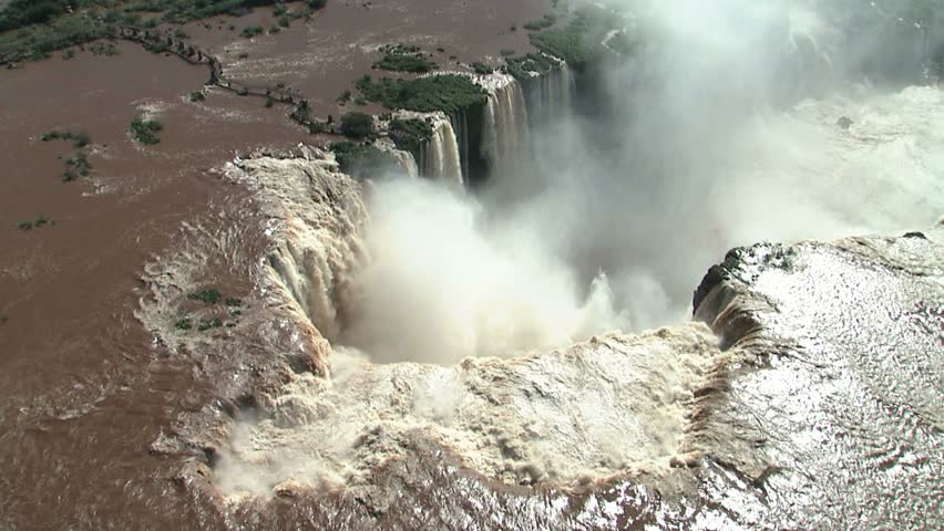 Iguazu Falls Aerial on Argentina/Brazil border as helicopter continues to move in to main fall, Garganta del Diablo