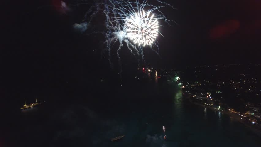 New Years amazing Fireworks display firing from yachts along the west coast city of Barbados in the Caribbean - Aerial View - January, 1st, 2017