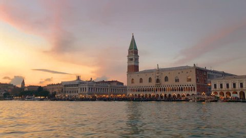 Venice city, Italy in Europe at sunset time, view from speed boat on the sea canal to San Marco square and Doges Palace. Beautiful italian architecture landmarks of Venezia, venetian travel background