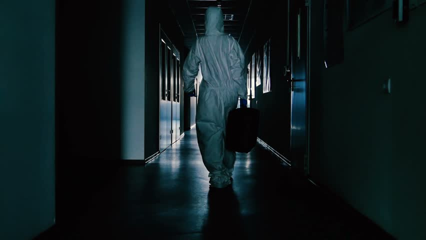 Young woman dancing in the corridor of the lab stock footage the scientist in protective suit and with bag going through the corridor 4k stock video sciox Images