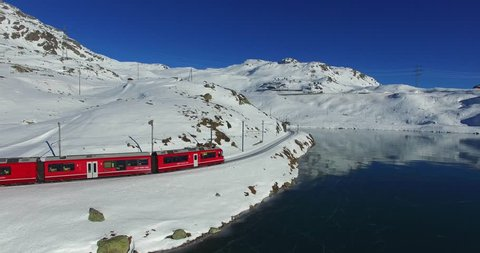 Red train on Bernina Pass in Winter season