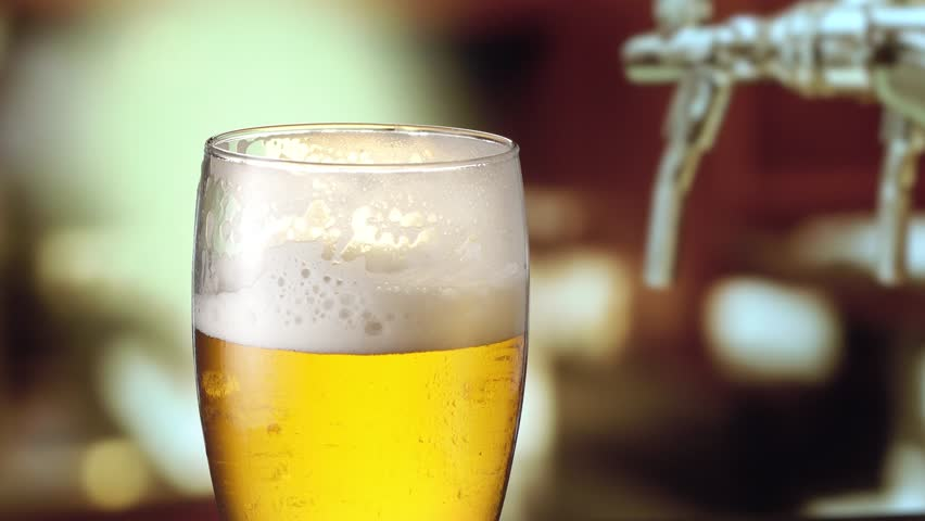 Beer is pouring from the top into the glass. 4K video. | Shutterstock HD Video #22811716