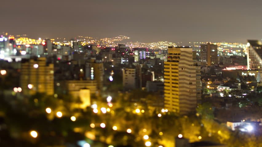 a time-lapse of the mexico city skyline at night