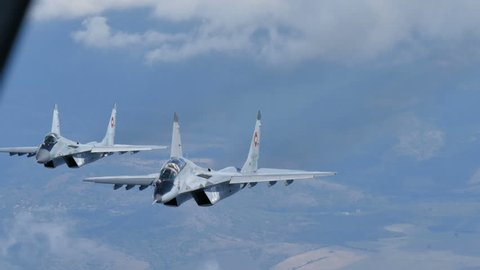 Cold War Combat Aircrafts in Flight. Mikoyan Gurevich MiG 29 Fulcrum of Bulgarian Air Force Air to Air 4K Ultra HD Video. The MiG-29 is a russian  military combat aircraft. Bulgaria 7th Oct. 2015.
