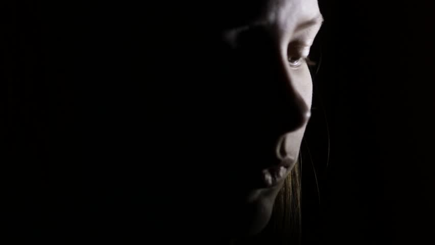 6 Closeup portrait of a depressed teen girl in the dark. 4K UHD. #22898293