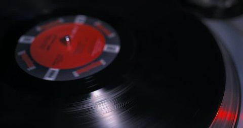 Placing DJ needle on spinning vinyl LP record player (New York, USA, January 2017)