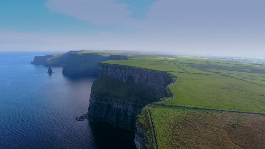 The amazing view of the Cliffs of Moher taken in a dusky afternoon in Ireland