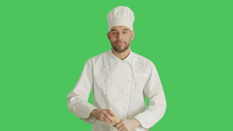 Mid Shot of a Chef Spicing Up Dishes with Pepper Box. Background is Green Screen. Shot on RED Cinema Camera 4K (UHD).