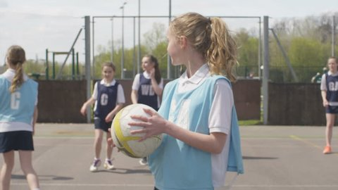4K Portrait young smiling netball player on outdoor court Dec 2016-UK