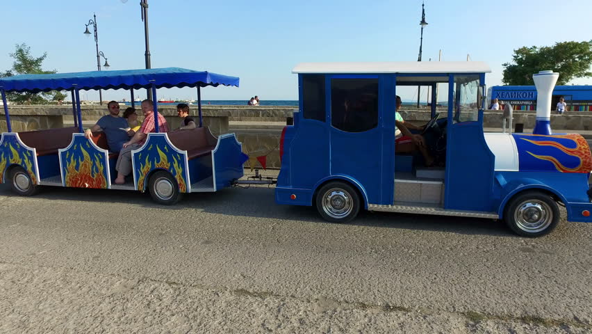 NESEBAR, BULGARIA - 10 AUGUST, 2016: The little tourist train takes visitors to commented tour of the city's old town historic center.