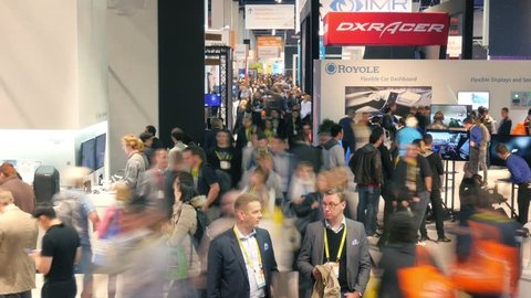 LAS VEGAS - January 7, 2017: Crowds of people at CES 2017 expo. CES is the world's leading consumer electronics trade show. 4K UHD timelapse.