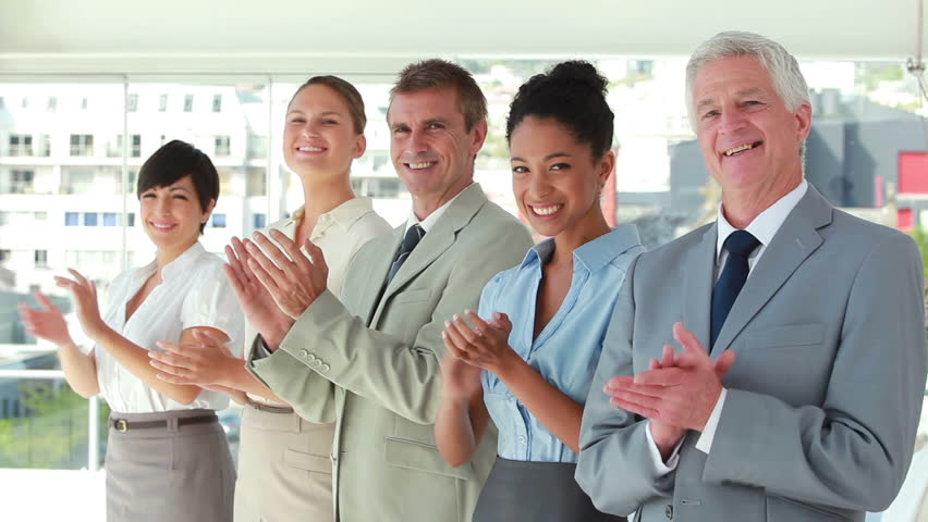 People in suit applauding in line in a bright room | Shutterstock HD Video #2299697