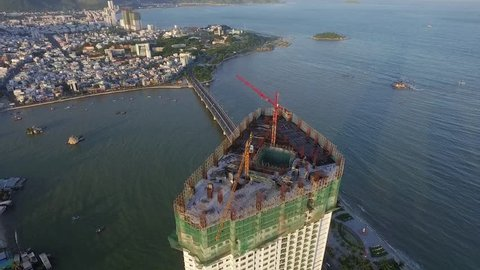 Aerial View of the Construction of a Skyscraper on a Background of the Sea, Asia, Vietnam