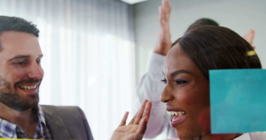 Businesspeople giving high five to each other in the office 4k   Shutterstock HD Video #23011102