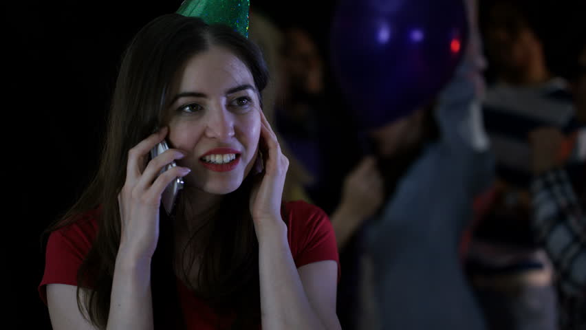 4K Happy girl trying to talk on phone at noisy house party Dec 2016-UK #23020933