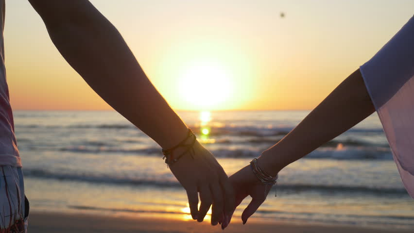 Young Couple Holding Hands On Stock Footage Video (100
