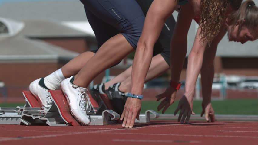 Track runners leave starting blocks in super slow motion, shot on 4K