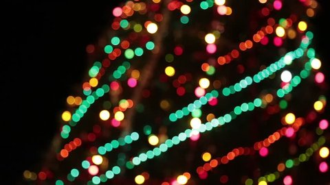 Christmas tree with colorful bokeh and christmas lights..Christmas and new year decoration. Abstract bokeh holiday background. Blinking garland. Christmas lights twinkling.