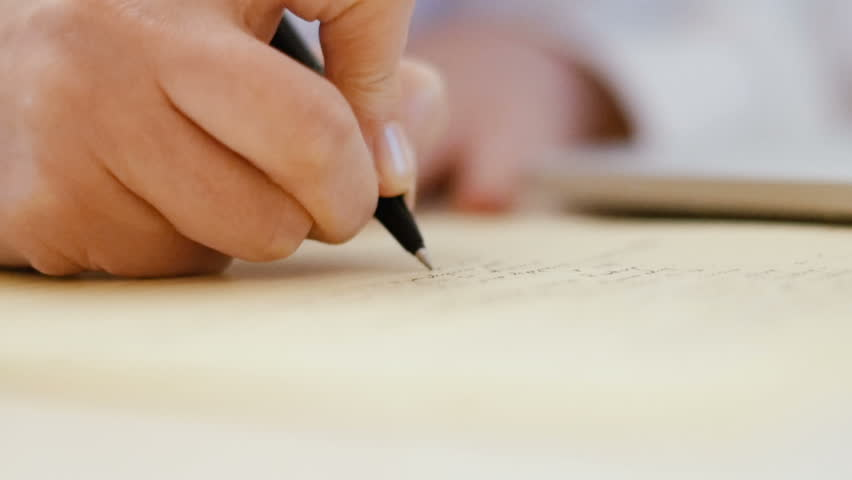 Slow-motion close-up detail of professional lawyer writing in her notebook diverse details   Shutterstock HD Video #23053672