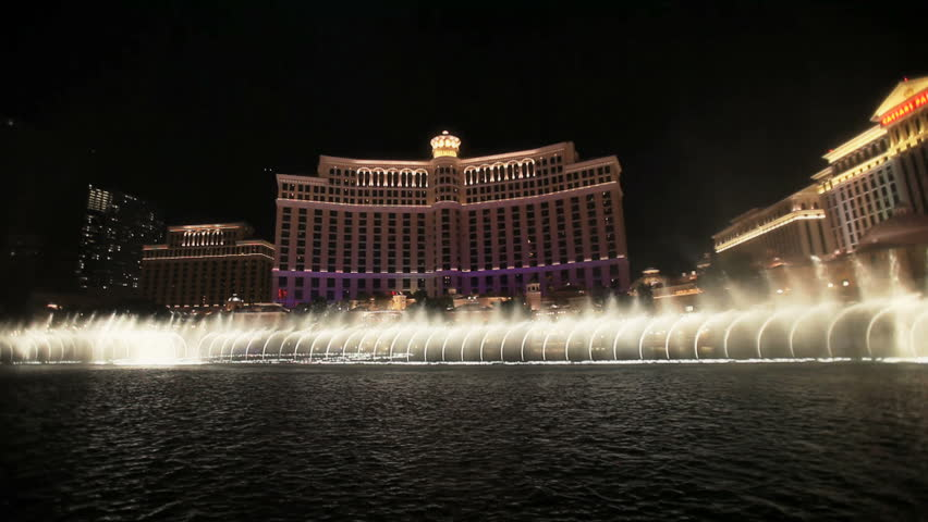 LAS VEGAS - CIRCA 2010: Water fountains dancing at night in front of the Bellagio circa 2010 in Las Vegas, Nevada.