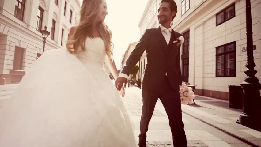 Just Married Couple Walking Down The Street on Wedding Sunny Day Slow Motion  | Shutterstock HD Video #23079463