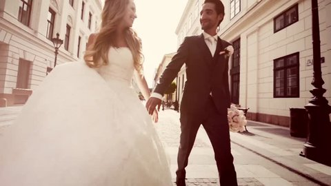 Just Married Couple Walking Down The Street on Wedding Sunny Day Slow Motion