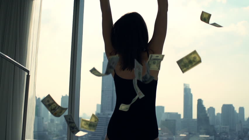 Successful, happy woman throwing money by window at home, super slow motion 240fps